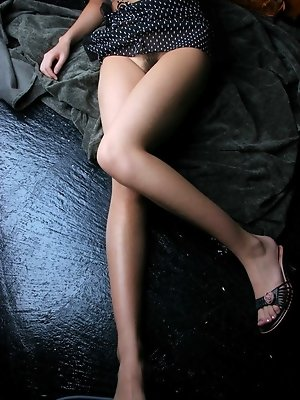 Adorable Asian model Erika rests naked before readying for a night at a party