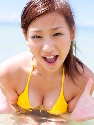 Ayaka Sayama Asian shows nasty behind in blue bath suit outdoor