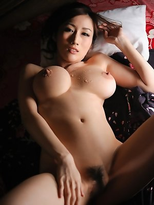 Julia Asian is so erotic while exposing big cans out of wrapper