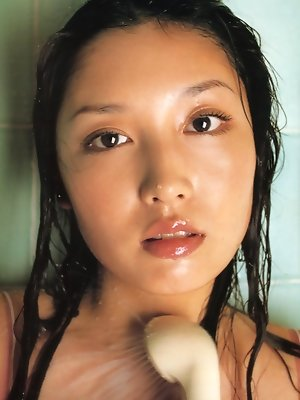 Long haired asian hottie in wet sexy see through cotton clothing