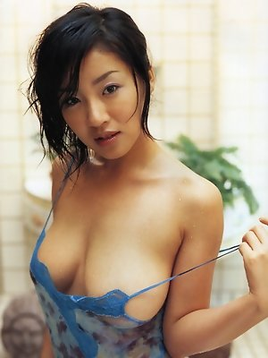 Curvey gravure idol with large breasts in see through lingerie