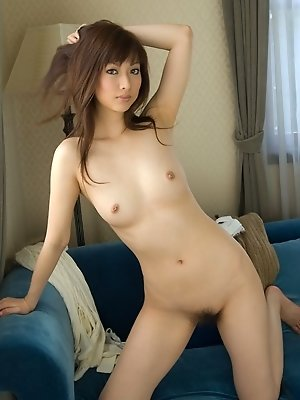 Lovely Reika enjoys stripping and showing off her nice tits and tight pussy